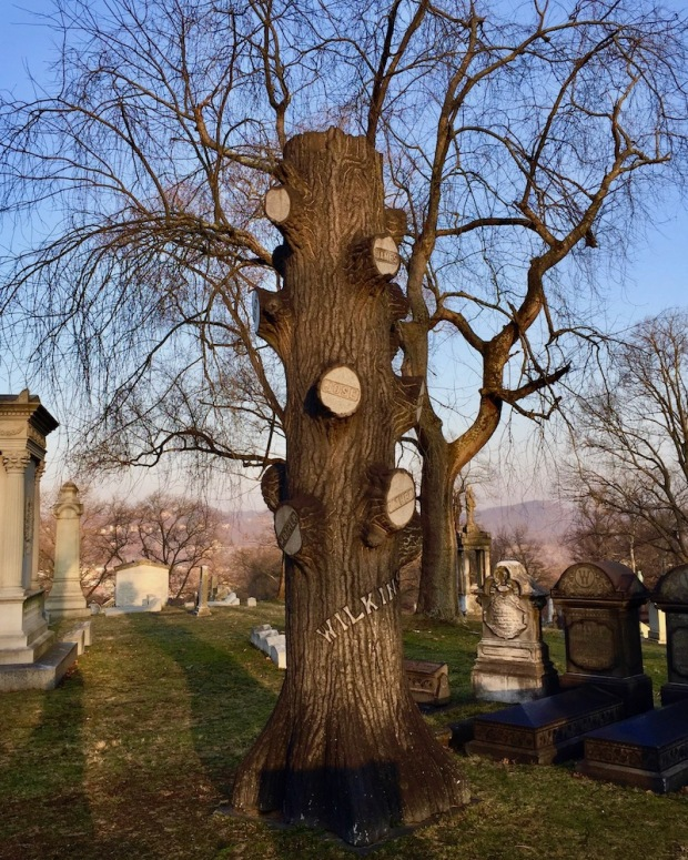 large family grave marker carved to look like tree trunk