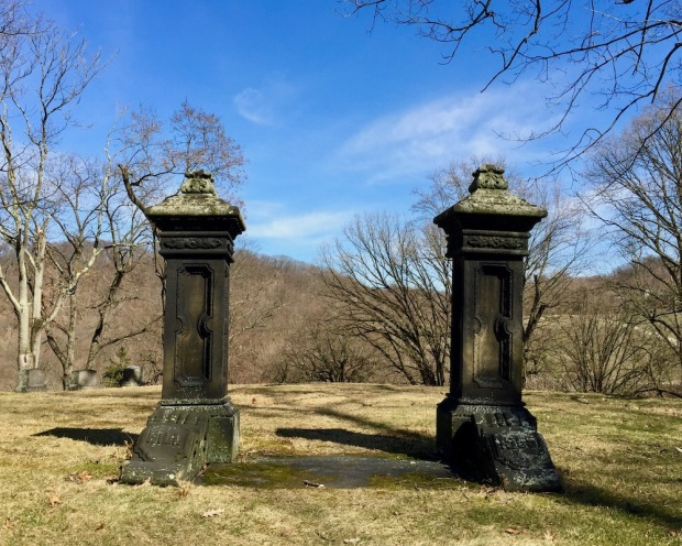 ornate gate-like entrance to empty cemetery plot