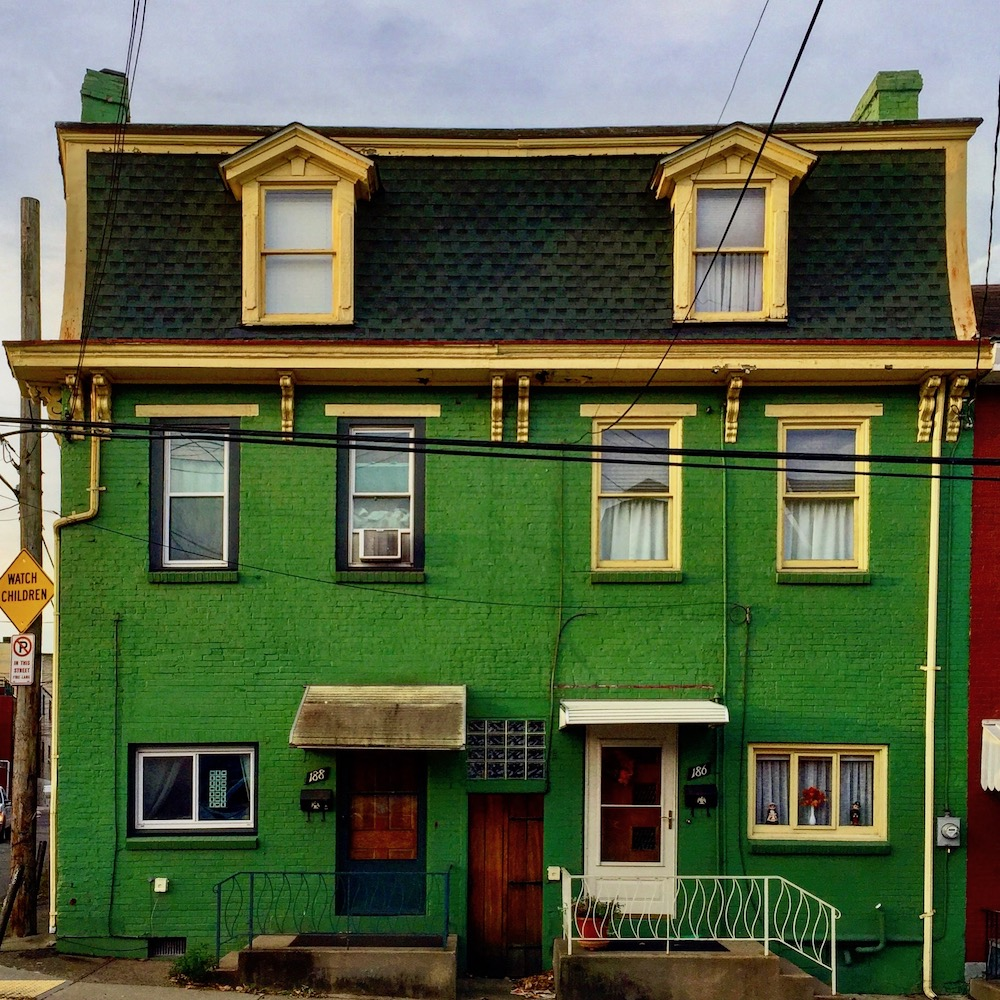 large row house painted bright green