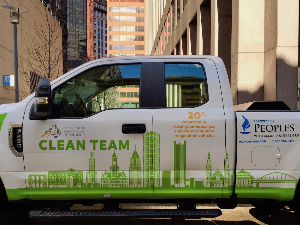 pickup truck with graphic of downtown Pittsburgh buildings