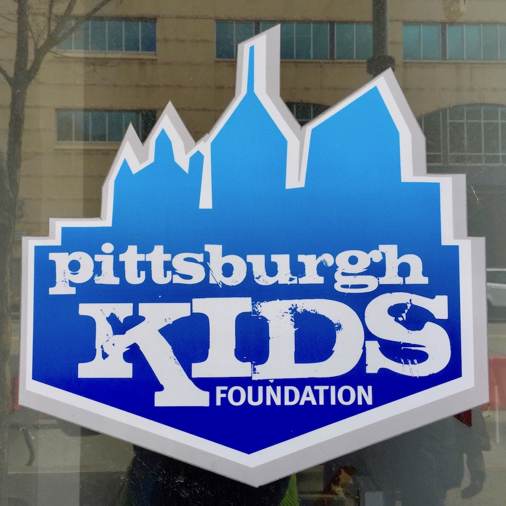 logo for Pittsburgh Kids Foundation featuring stylized downtown Pittsburgh skyline