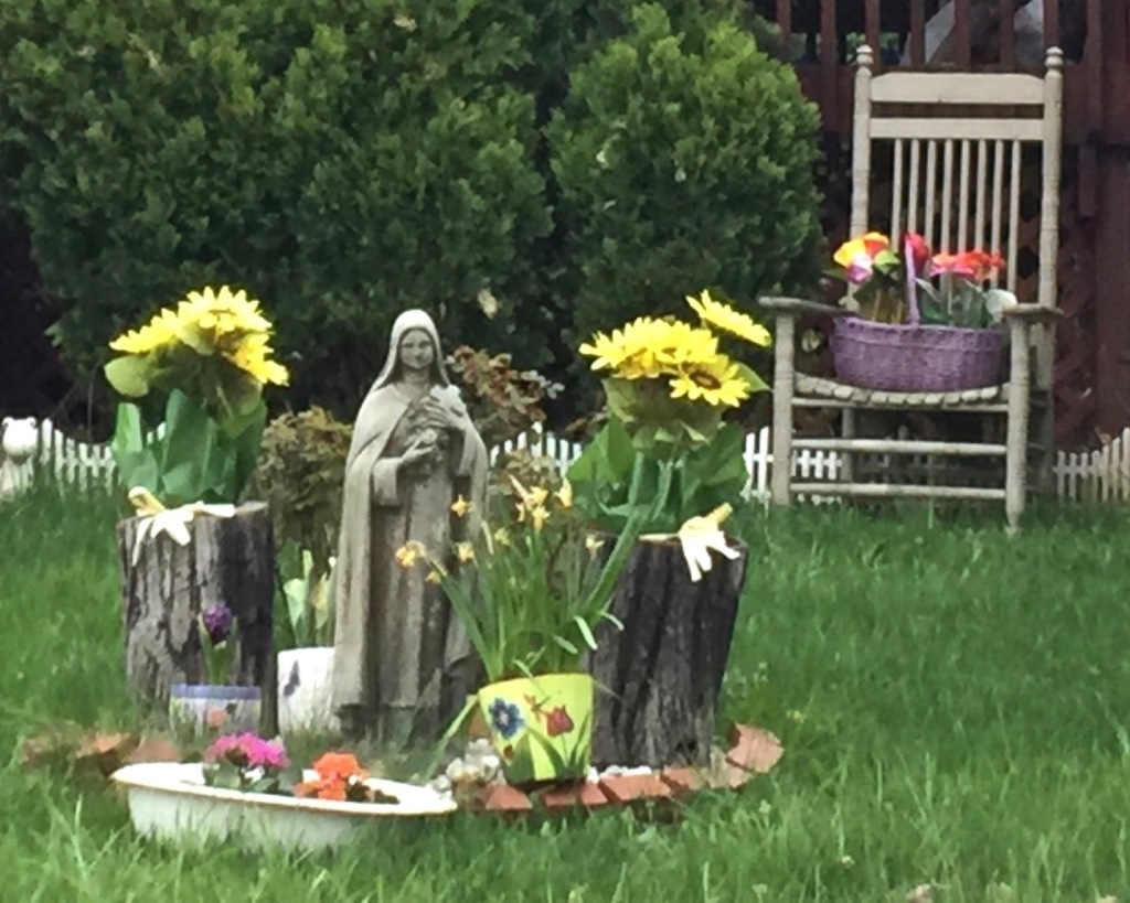 statue of nun in front yard of house