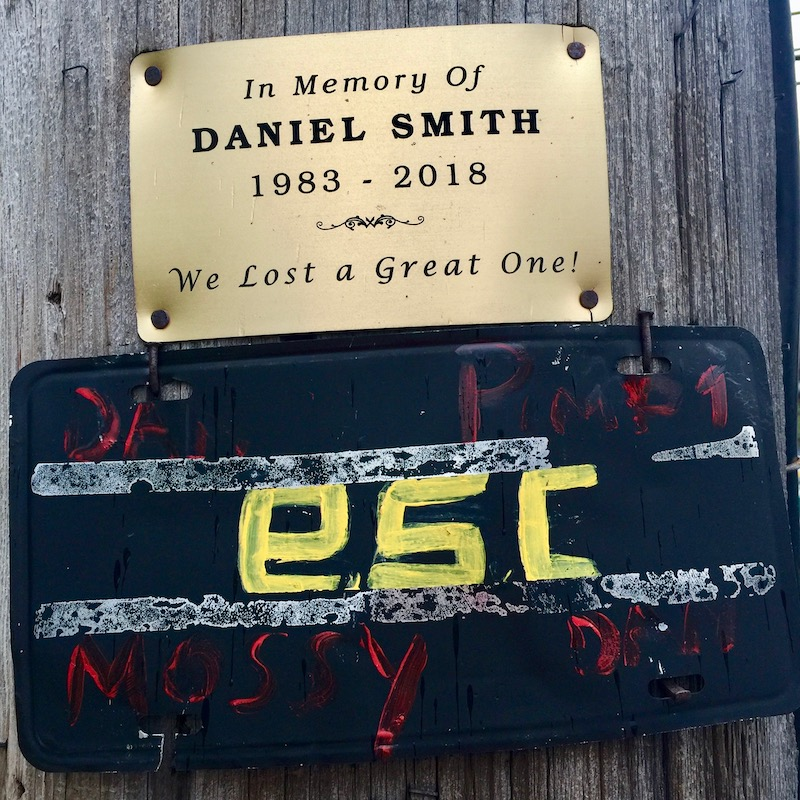 memorial plaque nailed to utility pole