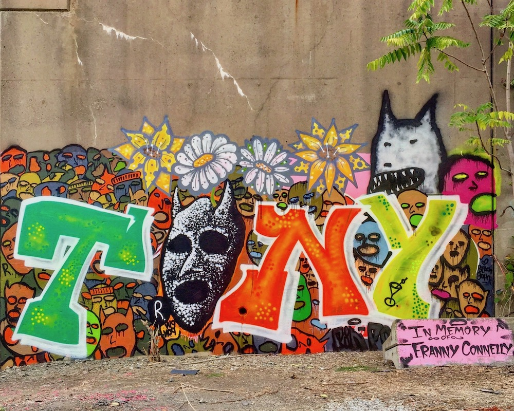 """memorial graffiti painting of the name """"Tony"""" on cement wall"""