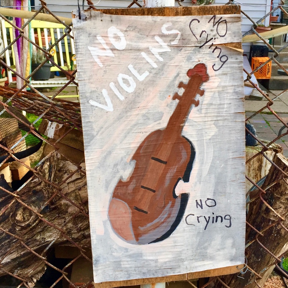 "painting of violin with with words ""No Violins"" and ""No Crying"""
