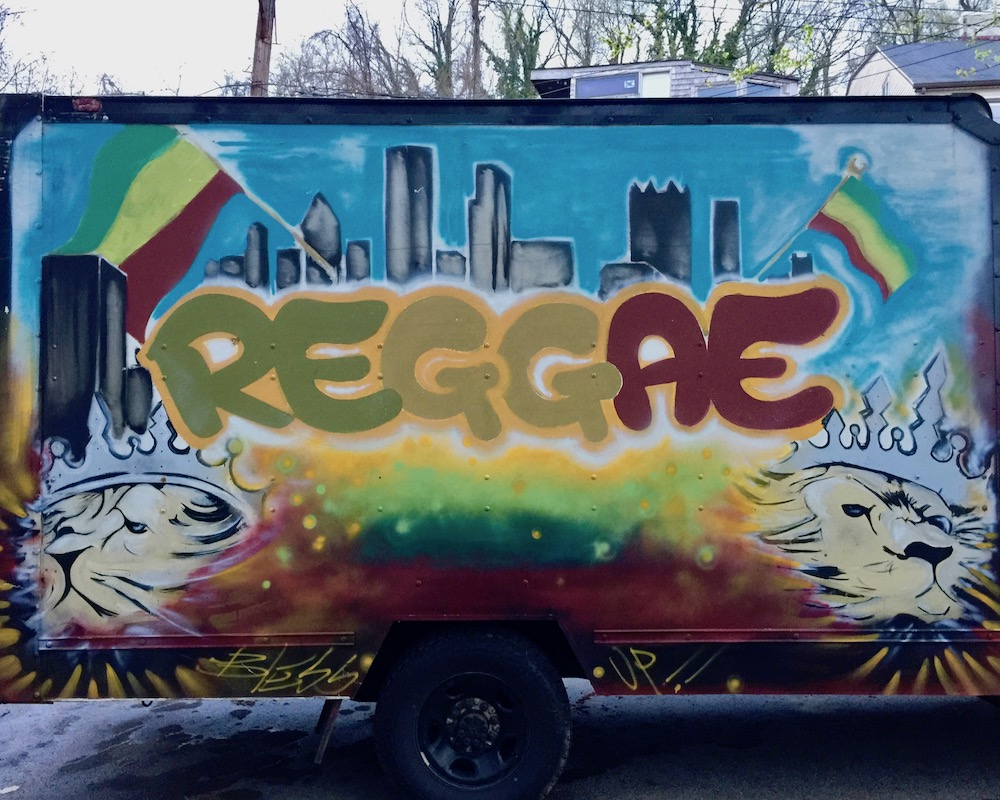 """box truck with painted with mural including the Pittsburgh skyline and the word """"Reggae"""""""