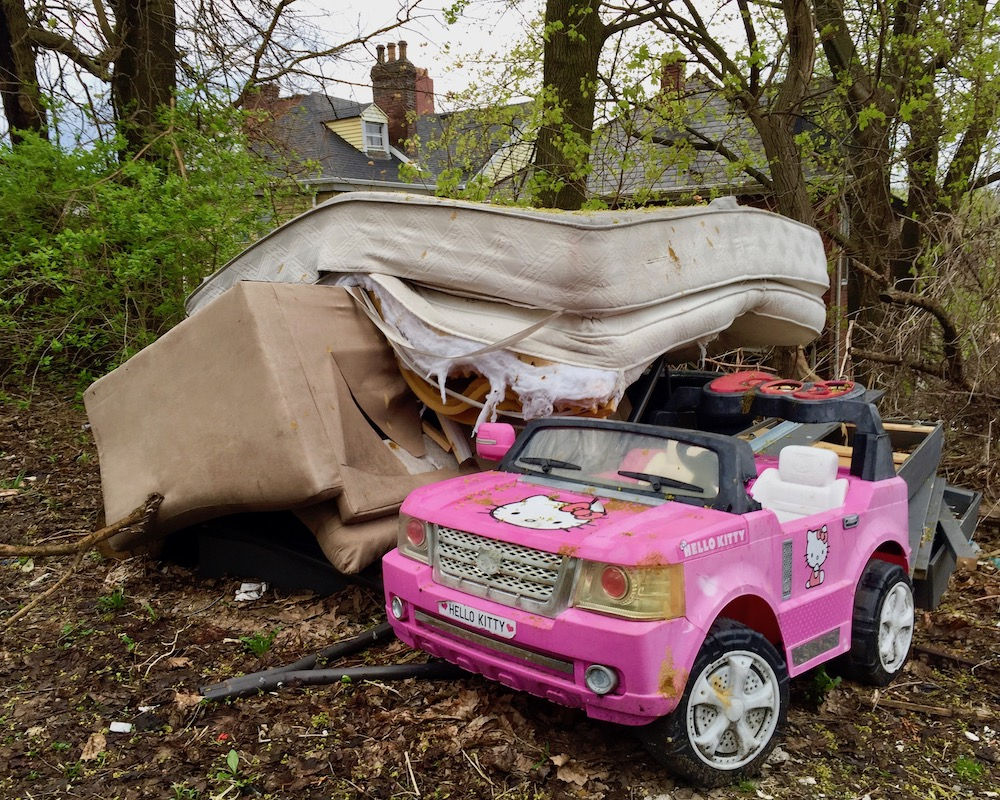 pink Hello Kitty toy car left out for trash pickup