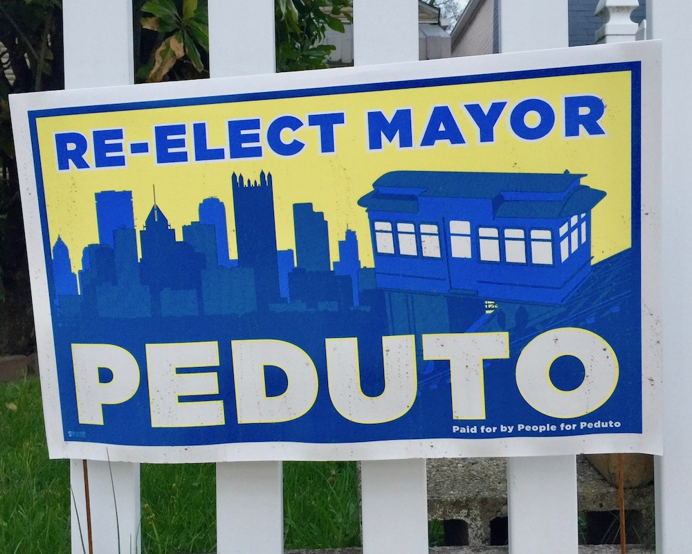 yard sign for Bill Peduto as Pittsburgh city mayor including the downtown Pittsburgh skyline