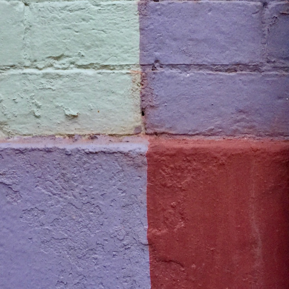 detail of row houses where paint colors make four perfect squares