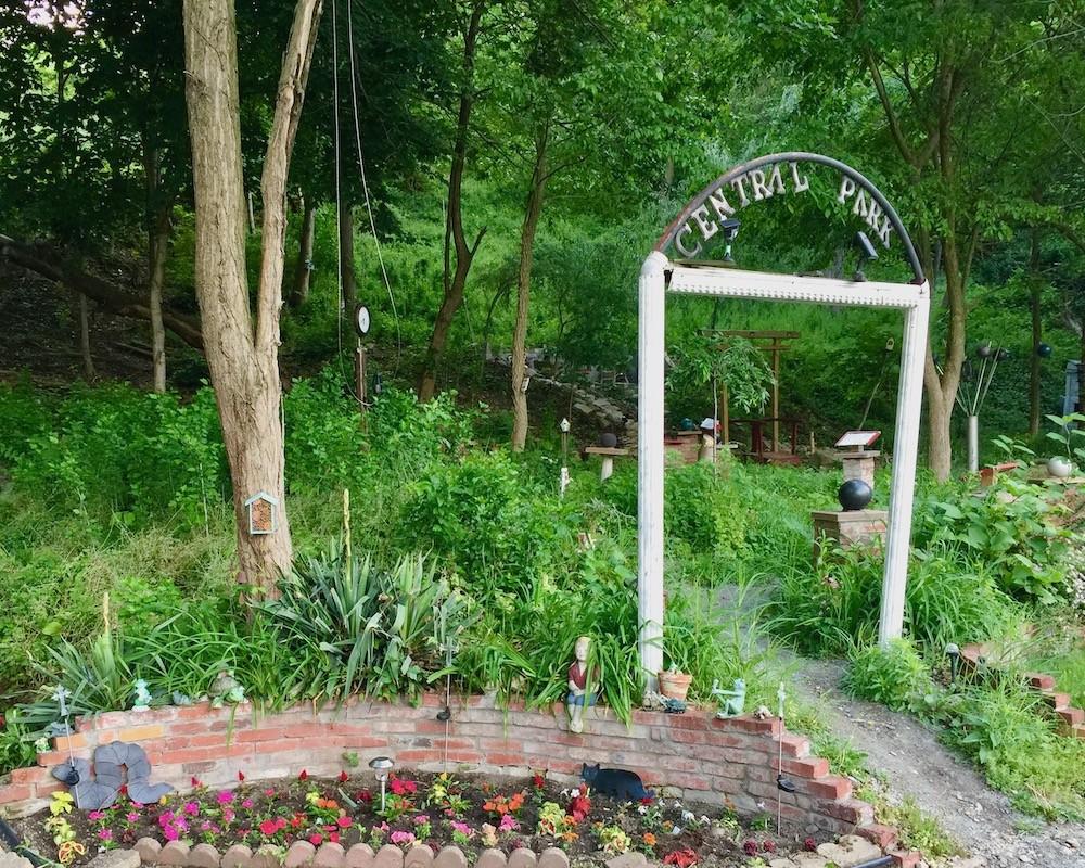 entrance to Pittsburgh's Central Park with ornamental gate and flower garden