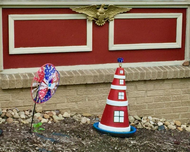 decorative yard lighthouse made from painted flower pots