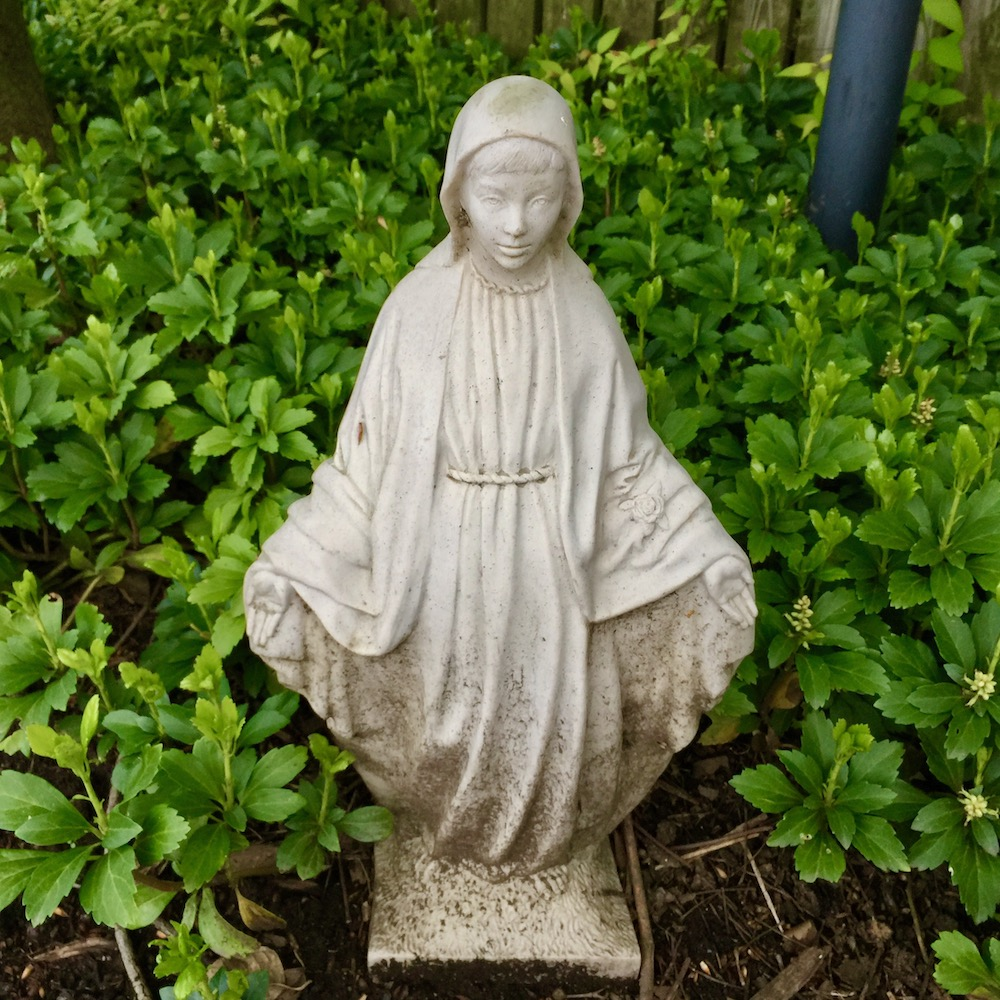 statue of Mary among leafy groundcover