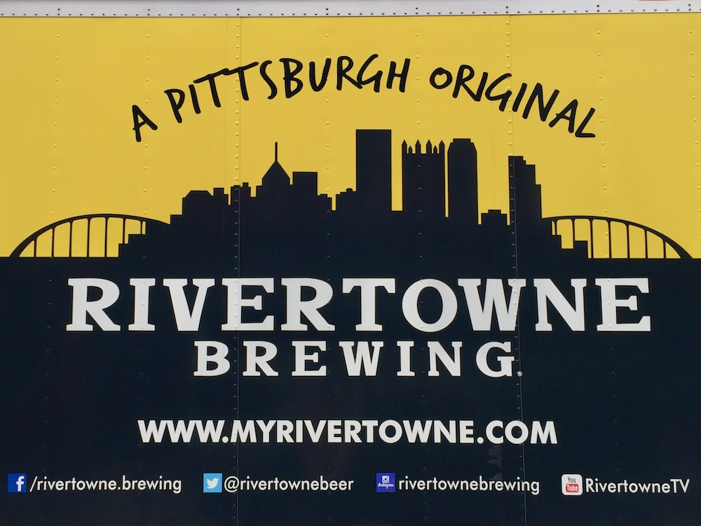 panel truck advertising Rivertown Brewing with silhouette of the downtown Pittsburgh skyline