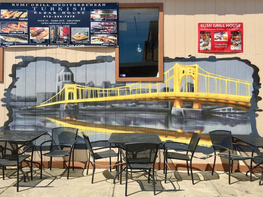 mural on restaurant's exterior wall showing bridge and downtown Pittsburgh skyline