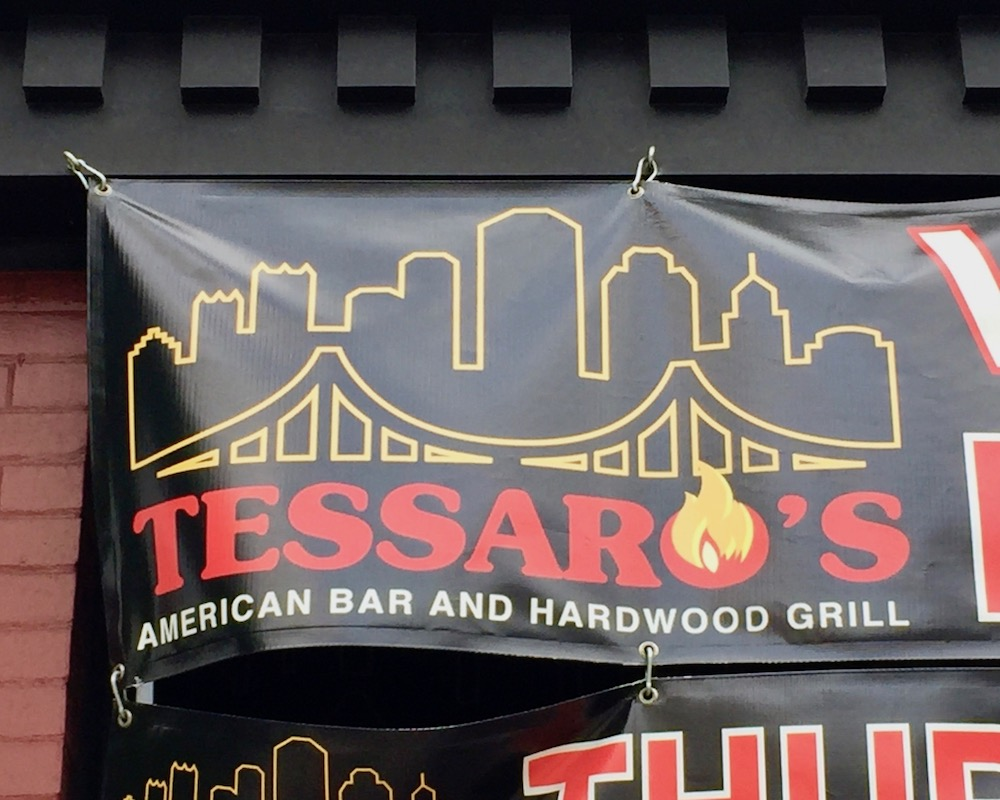 vinyl sign for Tessaro's restaurant including stylized downtown Pittsburgh skyline