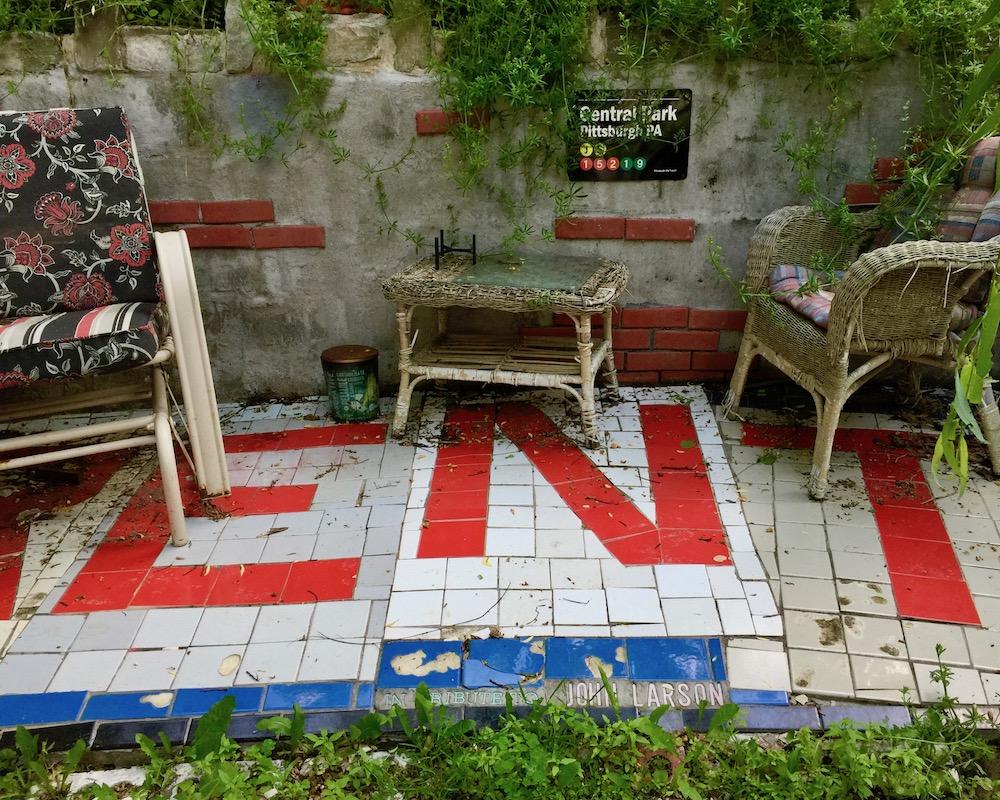 """tiled outdoor veranda spelling the word """"RENT"""""""
