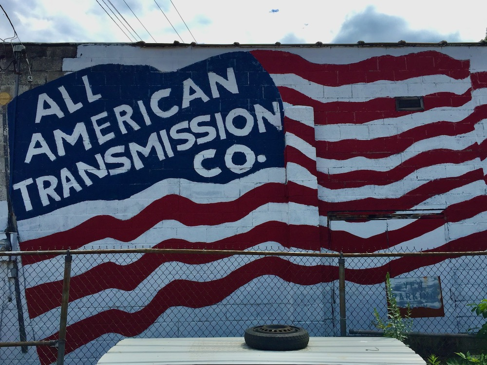 mural for All American Transmission Company with company name in giant waving American flag
