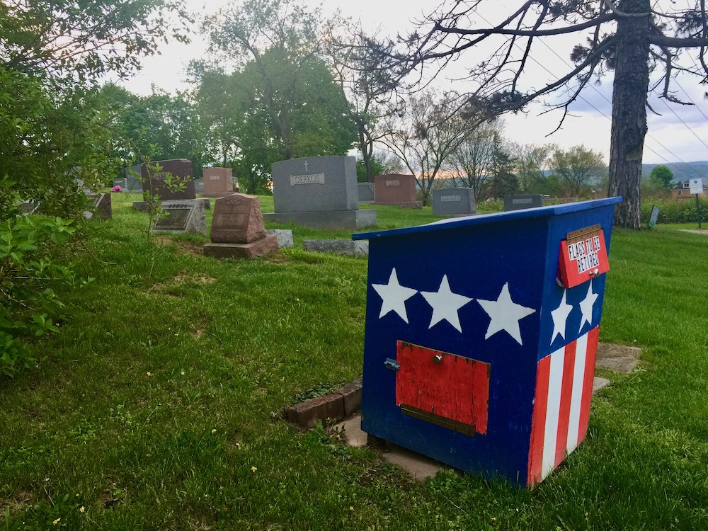retired flag box in small cemetery
