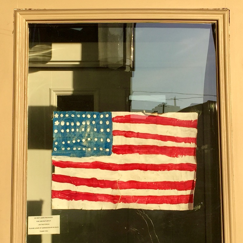 hand painted American flag taped to glass door