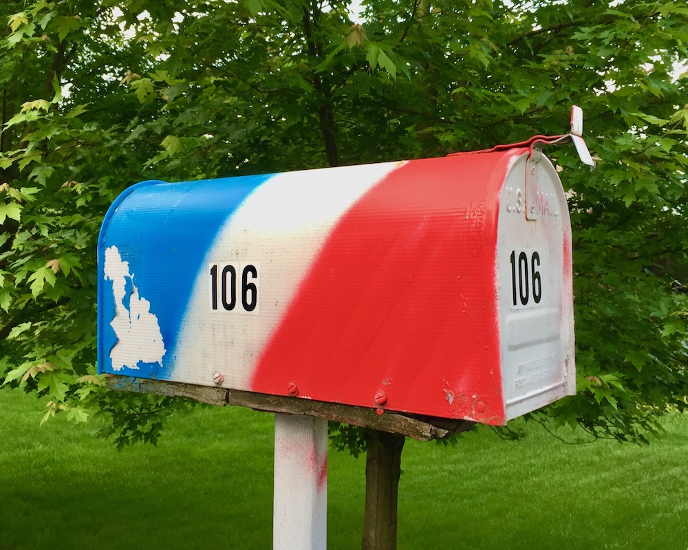 mailbox painted red, white, and blue