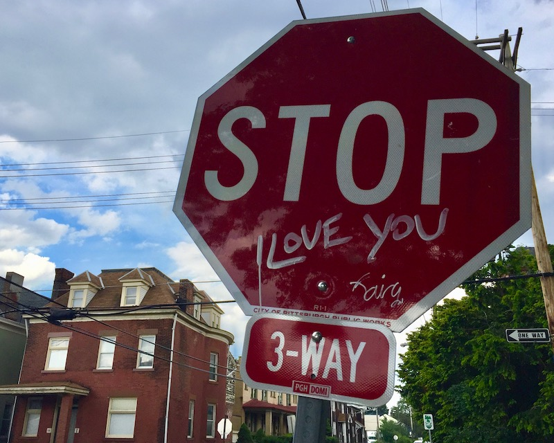 """stop sign with added text """"I love you"""""""