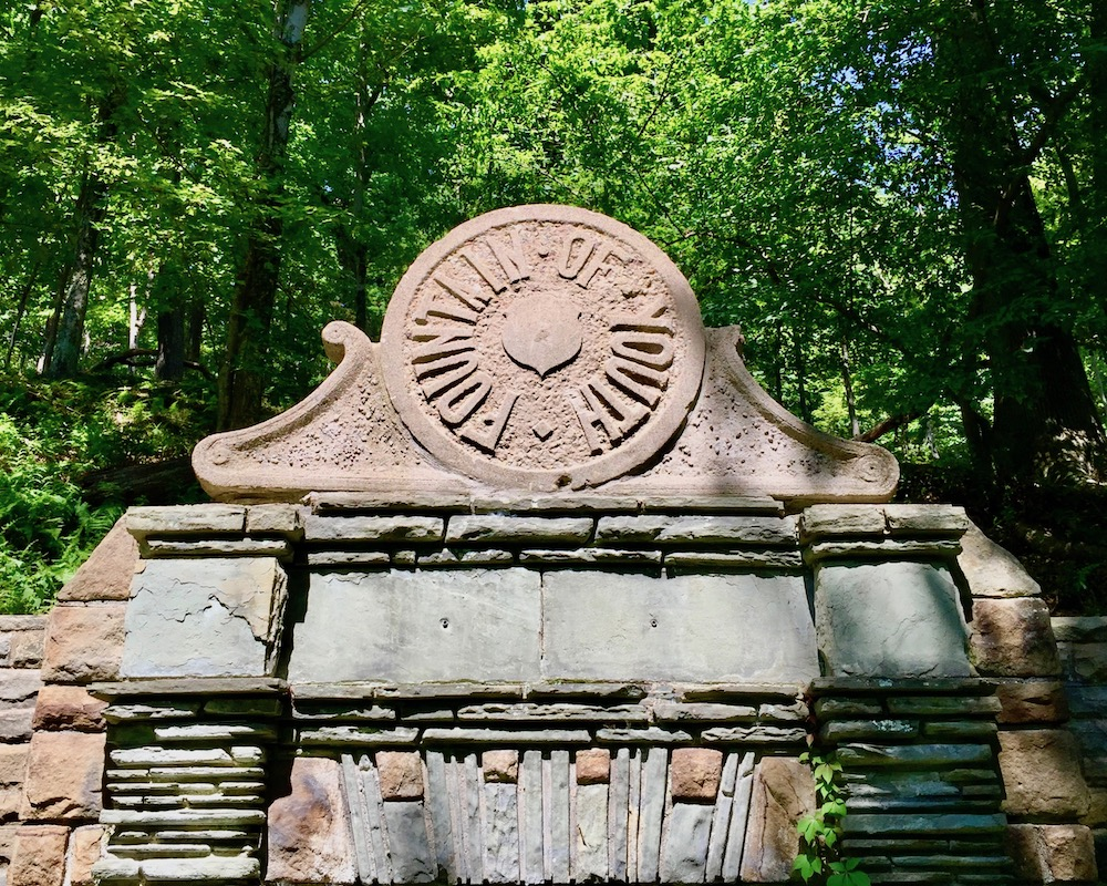 """detail of capstone on spring house engraved as """"Fountain of Youth"""""""