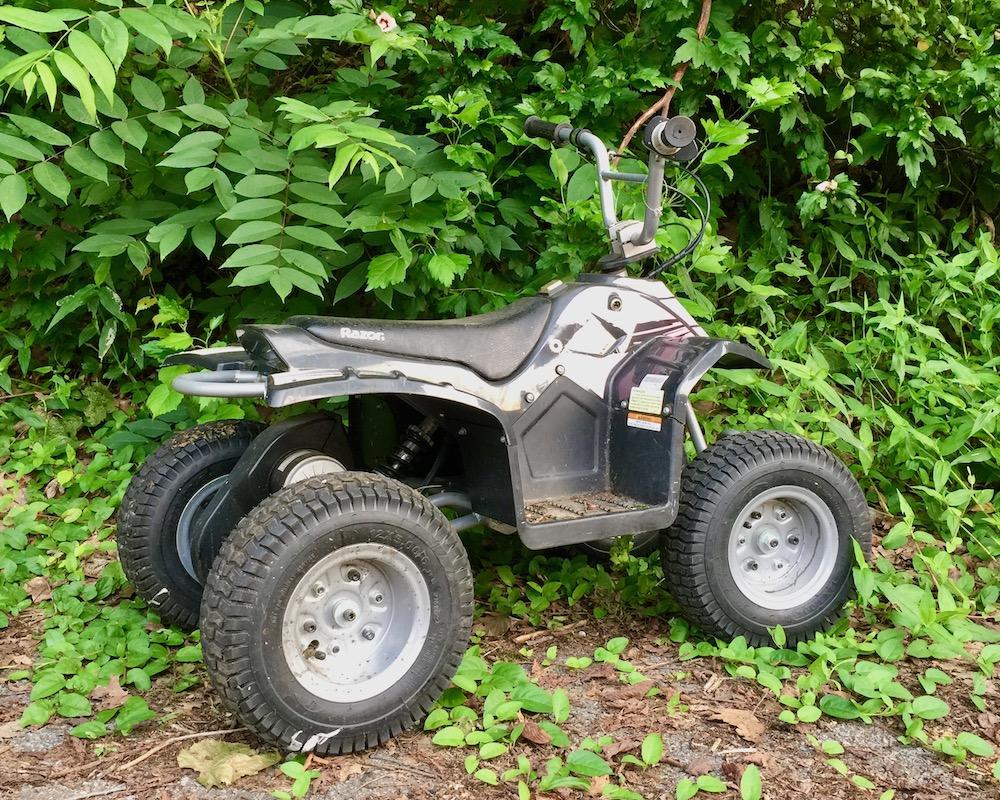 child's all-terrain vehicle left on roadside