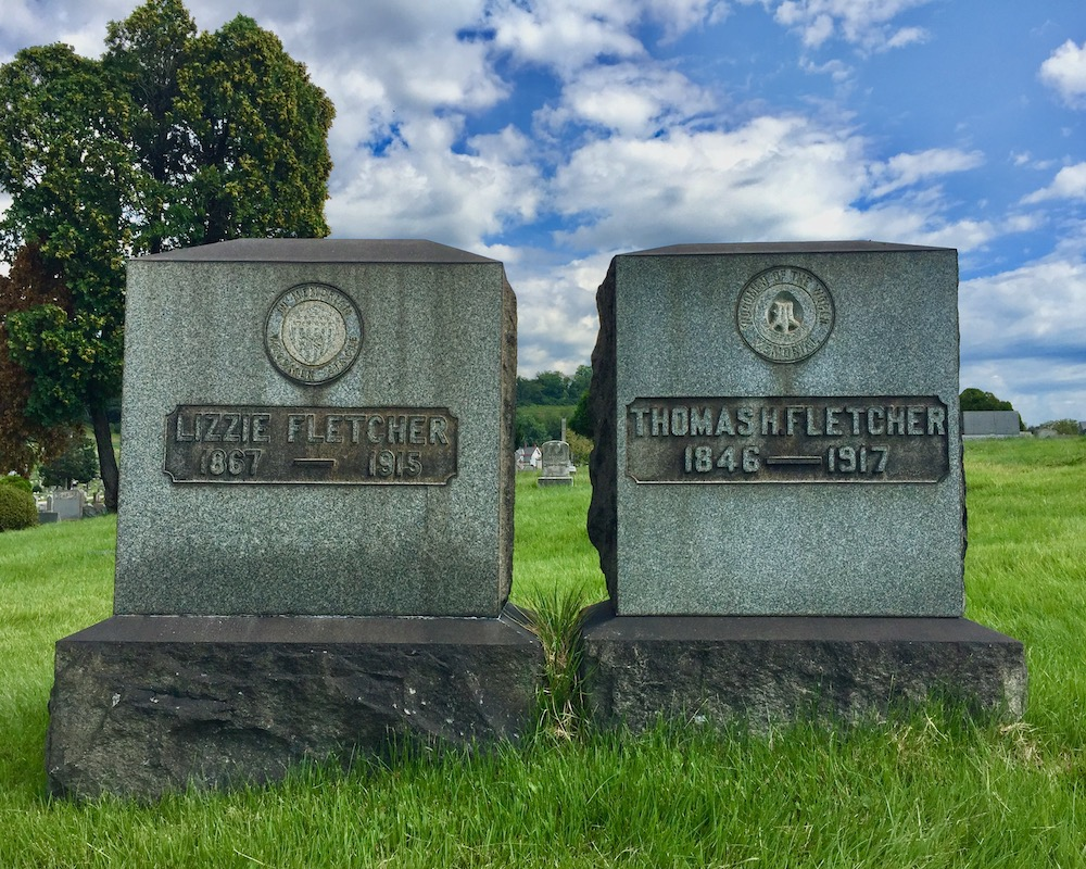 grave markers with seal of the Woodmen of the World, Richland Cemetery, Dravosburg, PA